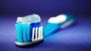 Toothbrush and toothpaste recommended by dentist.